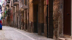 A rock street near closely placed houses and balconies in Cefalu, Stock Footage