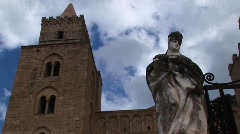 A cloud time lapse moving above a statue of a woman holding Stock Footage