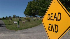 A dead end sign near a cemetery on a hillside. Stock Footage