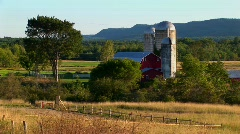 A barn near a field and trees at day in Vermont. Stock Footage