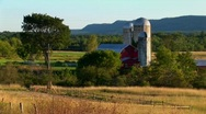 Stock Video Footage of A barn near a field and trees at day in Vermont.