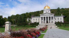 A stone walkway leads to the gold domed capital building in Stock Footage
