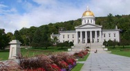 Stock Video Footage of A stone walkway leads to the gold domed capital building in