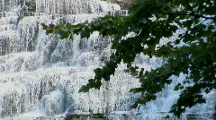 Water cascades down a rock hillside in Ithaca Falls, New York Stock Footage