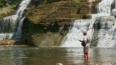 A fisherman in Ithaca Falls, New York Stock Footage