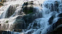 A wide waterfall flows over rock ledges in Ithaca Falls, New York. Stock Footage