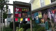 Hippie welcome signs on a Woodstock bulletin board in Woodstock, Stock Footage