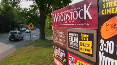 A Woodstock sign next to a street in Woodstock, New York. Stock Footage
