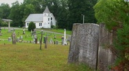 New England graveyard markers stand in an old cemetery near Stock Footage