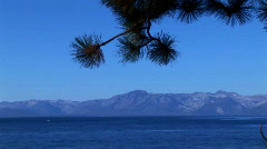 Clear, blue water in Lake Tahoe stretches out toward the base Stock Footage