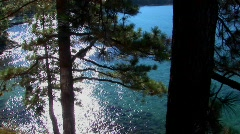 Aqua colored water in Lake Tahoe shimmers in the sunlight near Stock Footage