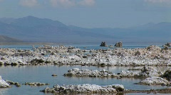 Water in Mono Lake, California touches tufa formations along - stock footage