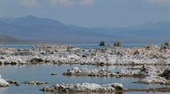 Stock Video Footage of Water in Mono Lake, California touches tufa formations along