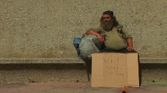 Two men hold up cardboard signs on the street Stock Footage