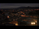 Sparkling city lights at dusk Stock Footage