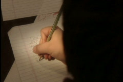 Young boy writes letter Stock Footage