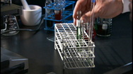 Lab beakers and microscope Stock Footage