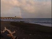Rainbow and pier Stock Footage