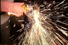Man splices metal with a machine Stock Footage
