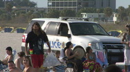 Stock Video Footage of Beach Cops On Patrol 01