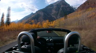Man drives on mountain road in fall Stock Footage