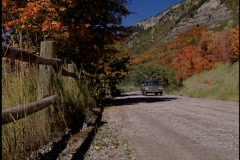 Car drives on mountain road Stock Footage