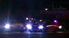 Police car with flashing lights during bust - stock footage