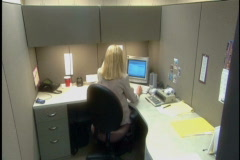 Woman works in cubicle Stock Footage