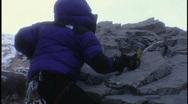 Mountain climber uses axes Stock Footage