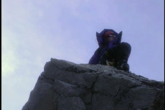 Mountain climber sits on peak 1 Stock Footage