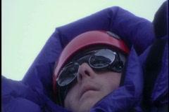 Mountain climber looks over terrain Stock Footage