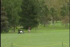 Man swings golf club Stock Footage