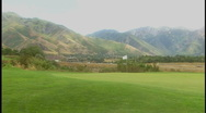 Golf course and mountains Stock Footage