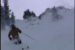 Expert skier skis down moutain Stock Footage