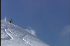 Expert skier skis down moutain - stock footage
