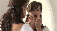 HD1080i Make-Up. An young model putting on lipstick. Stock Footage