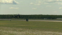 Military, F15 Eagle fighter jet landing follow shot Stock Footage