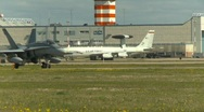 Military, F18 Hornet fighter jet taxi with AWACS in bg Stock Footage