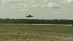 Military, F18 Hornet fighter jet landing follow shot Stock Footage
