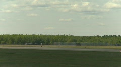 Military, F15 Eagle fighter jet landing through frame Stock Footage