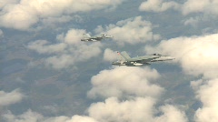 military aerial, F18 Hornet fighter jet in flight banking with clouds - stock footage
