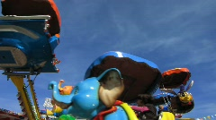 Carnival animal figure carousel turning - stock footage