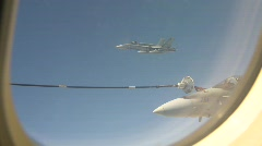 military, F18 Hornet fighter jet refuel with F18 in bg - stock footage
