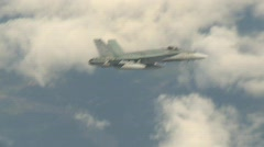 military, F18 Hornet fighter jet with clouds - stock footage