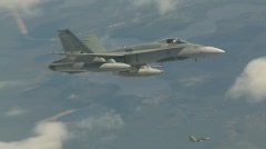 Military, F18 Hornet fighter jet in flight, 2nd in Hornet in bg below Stock Footage