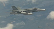 Stock Video Footage of military, F18 Hornet fighter jet in flight, 2nd in Hornet in bg below