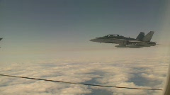military aerial, F18 Hornet fighter jet in flight off the refueler's wing - stock footage