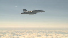 military aerial, F18 Hornet fighter jet in flight above the clouds, medium wide  - stock footage