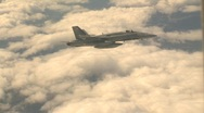 Stock Video Footage of military, F18 Hornet fighter jet banking with clouds in bg