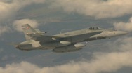 Military aerial, F18 Hornet fighter jet in flight, banking Stock Footage